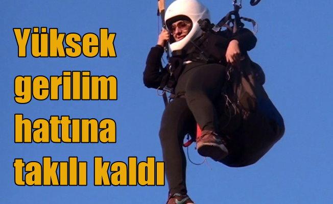 Kadın paraşütçü elektrik tellerine takılıp kaldı