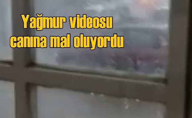 Yağmuru cep telefonuyla videoya kayıt ederken yıldırım cekti