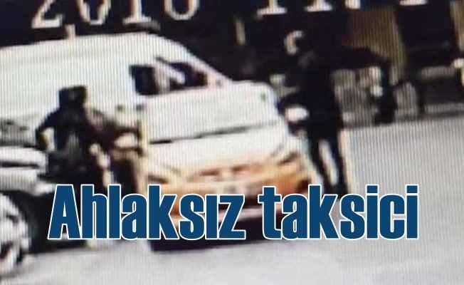Ahlaksız taksici, kandıramadığı turistin yüzüne tükürdü