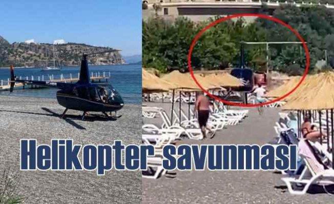 Plaja inen helikopter için işletme sahibinden savunma