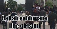 Atatürk anıtına baltayla saldıran kişiye linç girişimi