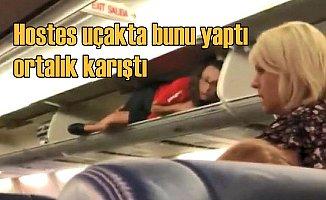 Hostes, el bagajına uzanıp yolcularla sosyal medya yıkıldı