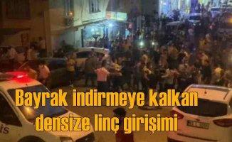 Türk bayrağını indirmeye kalktı, linçten polis kurtardı