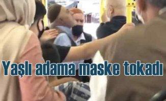 Otobüste maske tartışması, maskesini çıkardı yüzüne tükürdü
