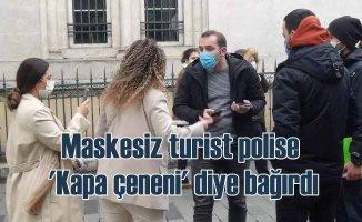 Maske takmayan turist, polise hakaret etti