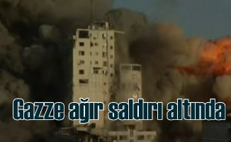 İsrail füzeleri binaları vuruyor, 13'ü çocuk 56 ölü var
