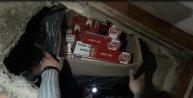 Elbise dolabının altına gizli odada 2 bin 159 paket kaçak buludu